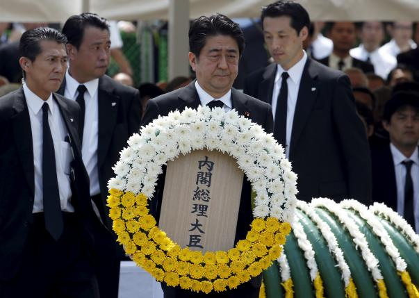 Japan's PM Abe offers a flower wreath for the victims of the 1945 atomic bombing at Nagasaki's Peace Park in Nagasaki