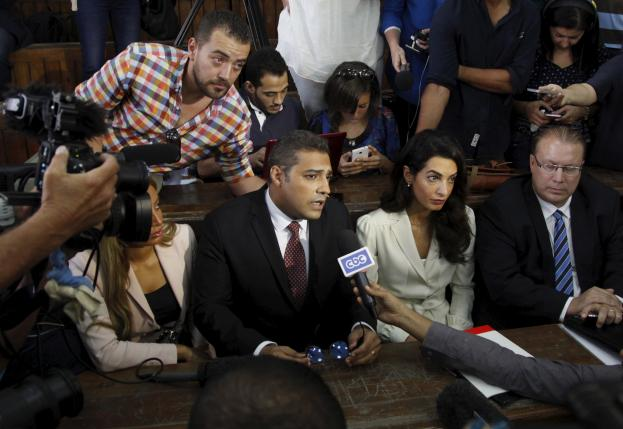Fahmy and Mohamed talk to the media at a court in Cairo