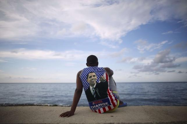 Medical student Electo Rossel listens to music at the Malecon seafront outside the U.S. embassy in Havana, Cuba