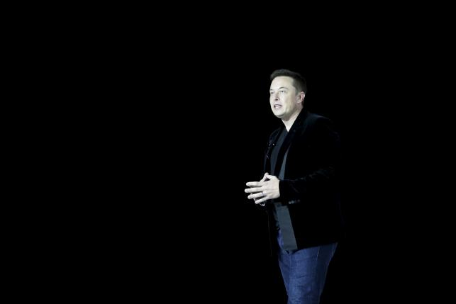 esla Motors CEO Elon Musk delivers Model X electric sports-utility vehicles during a presentation in Freemont