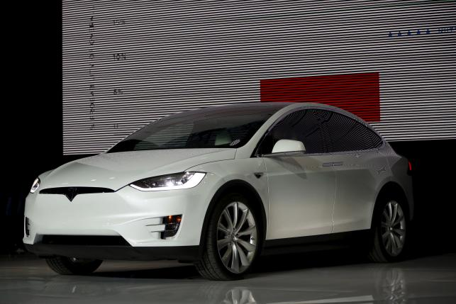 A Tesla Motors Model X electric sports-utility vehicles is seen on stage a presentation in Freemont