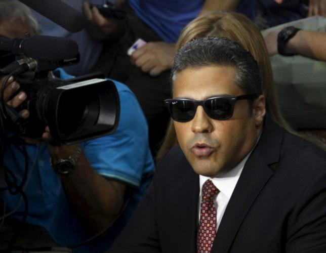 Fahmy talks to the media before the verdict at a court in Cairo