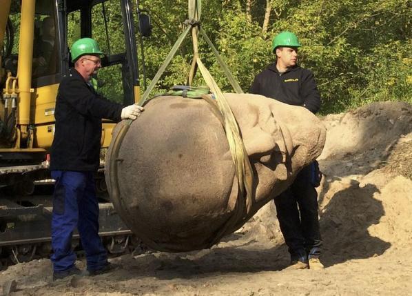 A granite sculpture of Soviet leader Vladimir Lenin's head is excavated southeast of Berlin