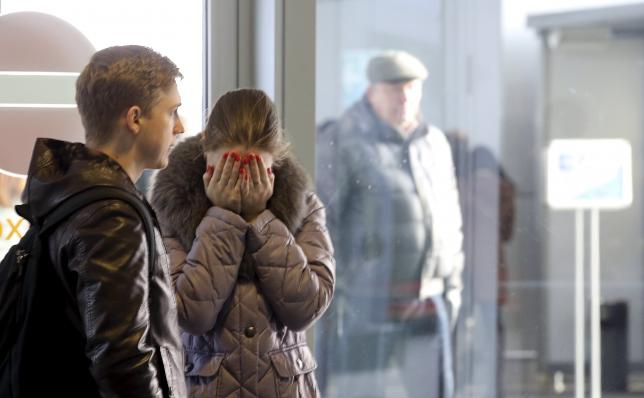 A woman reacts at Pulkovo airport in St. Petersburg
