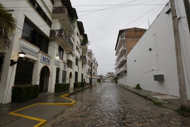 An empty cobblestone road is pictured at the tourist center in the Pacific beach resort city of Puerto Vallarta, Mexico