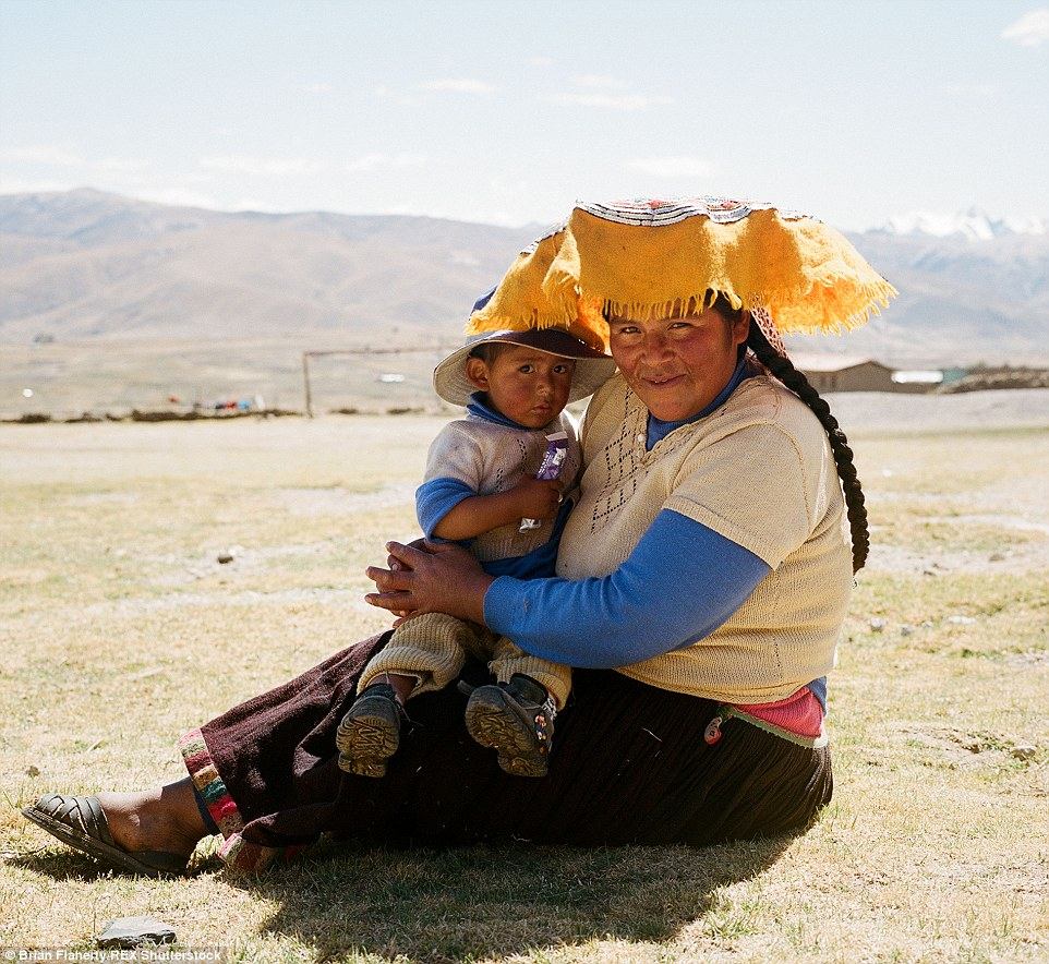 2E4BABC700000578-3311645-A_local_farmer_sits_and_holds_her_small_son_in_Pacchanta_Brian_s-a-16_1447153963394