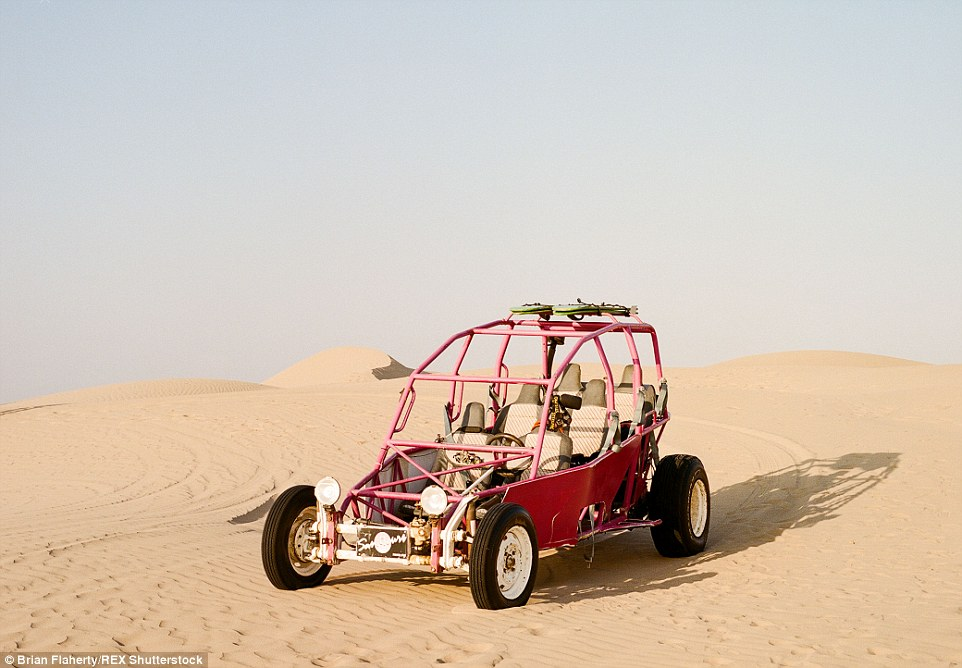 2E4BABD900000578-3311645-A_six_seater_dune_buggy_sits_alone_in_the_sand_near_the_city_of_-a-7_1447153963375