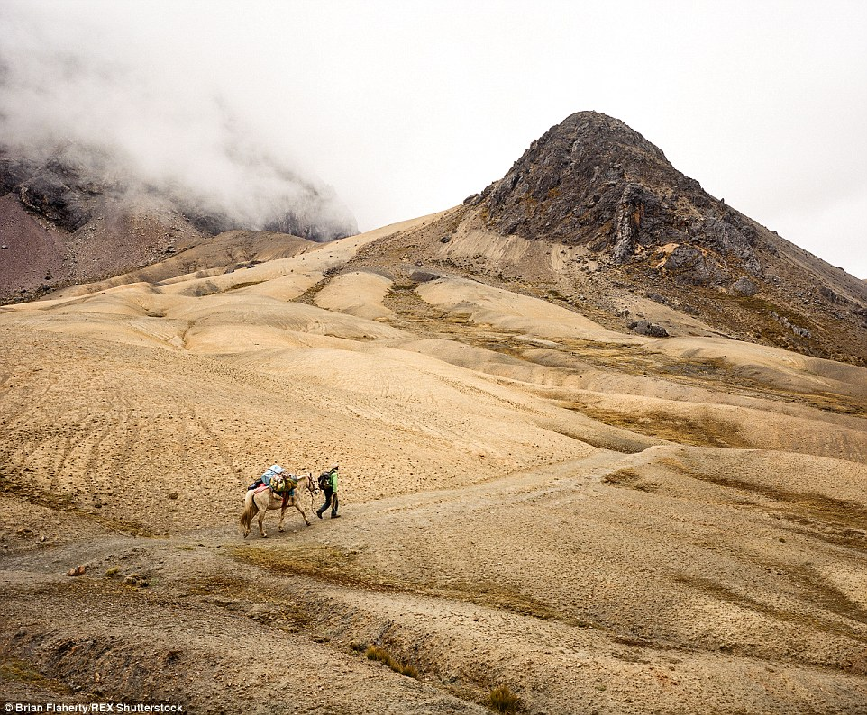 2E4BACA700000578-3311645-A_trekking_guide_leads_his_horse_through_the_rugged_extremes_of_-a-6_1447153963374
