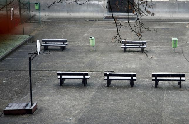 An empty playground is pictured at a closed primary and secondary school in Brussels