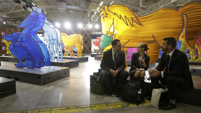 Delegates take a break during the opening day of the World Climate Change Conference 2015 at Le Bourget, near Paris