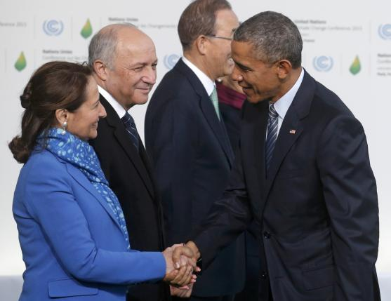 U.S. President Obama is welcomed by French Ecology Minister Royal and French Foreign Affairs Minister Fabius as he arrives for the opening day of the World Climate Change Conference 2015 (COP21) at Le Bourget, near Paris