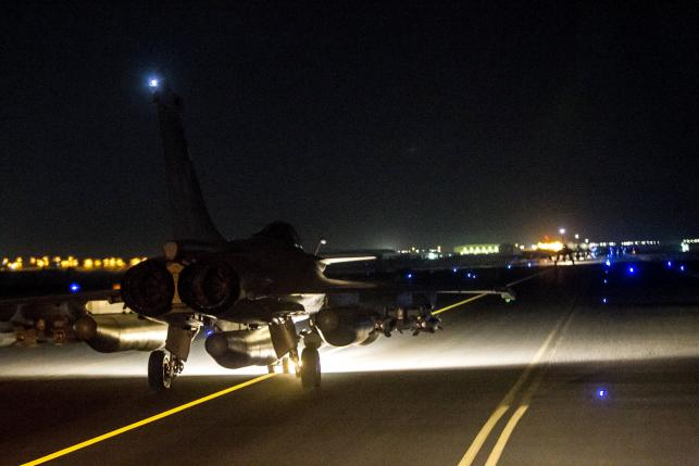 A French fighter jet taxis along the runway in an undisclosed location, in this handout picture released by the ECPAD