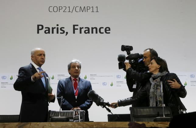 French Minister of Foreign Affairs Laurent Fabius and Peru's Minister of Environment Manuel Pulgar Vidal visit a conference room on the site of the World Climate Change Conference 2015 in Le Bourget