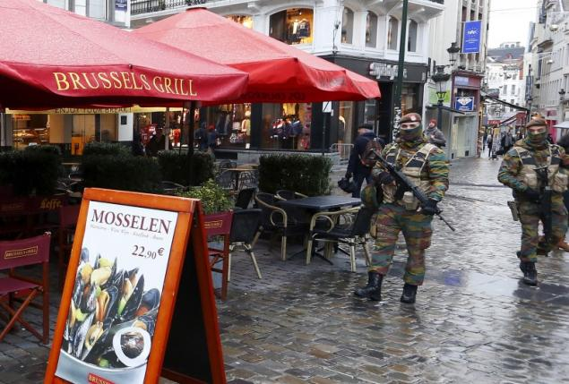 Belgian soldiers patrol nearby Brussels' Grand Place after security was tightened in Belgium following the fatal attacks in Paris.