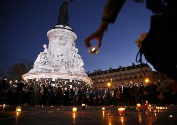 A candle is placed during a vigil in Place de la Republique following the series of deadly attacks in Paris