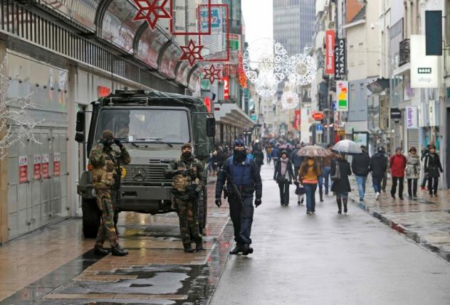 Belgian soldiers patrol a shopping street in central Brussels after security was tightened in Belgium following the fatal attacks in Paris