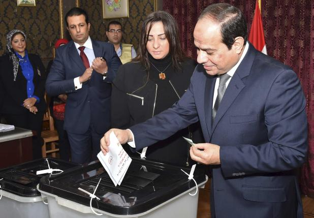 Egypt's President Abdel Fattah al-Sisi casts his vote at a polling station during the second round of parliamentary elections at Heliopolis, in Cairo, Egypt