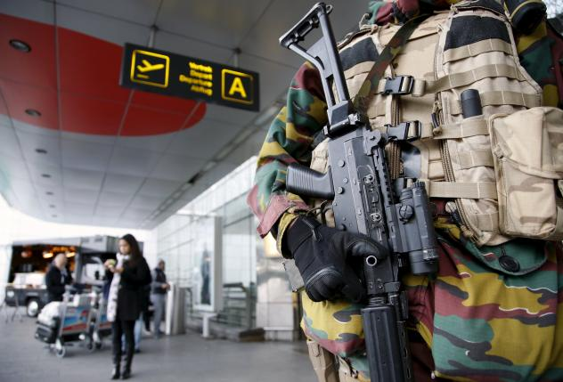 A Belgian soldier stands guard at the entrance of Zaventem international airport near Brussels