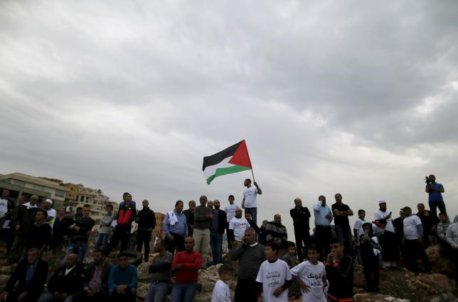 Israeli Arab protesters take part in a demonstration against the outlawing of the Islamic Movement's northern branch, in the northern Israeli-Arab town of Umm el-Fahm