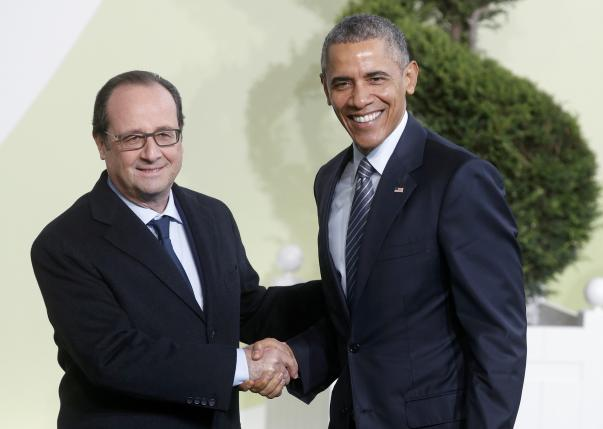 French President Hollande welcomes U.S. President Obama as he arrives for the opening day of the World Climate Change Conference 2015 (COP21) at Le Bourget, near Paris