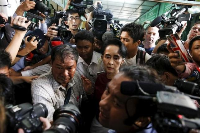 Myanmar's National League for Democracy party leader Aung San Suu Kyi leaves after casting her ballot during the general election in Yangon