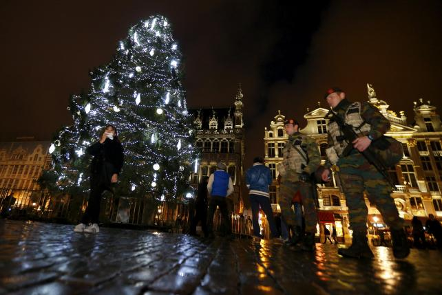 Belgian soldiers patrol Brussels' Grand Place after security was tightened in Belgium following the fatal attacks in Paris.