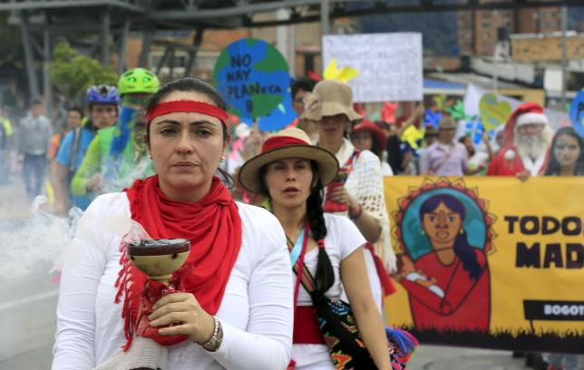 Women activists take part in a march ahead of the 2015 Paris Climate Change Conference, known as the COP21 summit, in Bogota