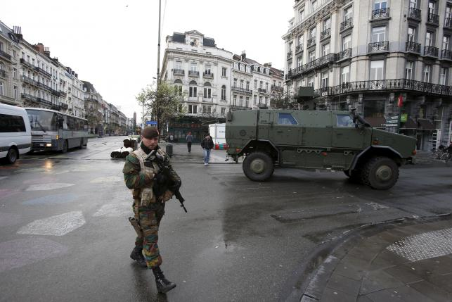 Belgian soldiers patrol in central Brussels, after security was tightened in Belgium following the fatal attacks in Paris
