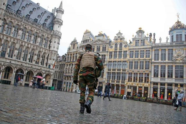 A Belgian soldier patrols on Brussels Grand Place in central Brussels after security was tightened in Belgium following the fatal attacks in Paris