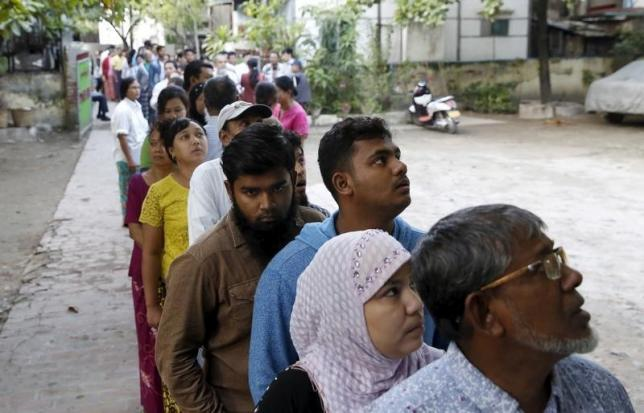 People line up to vote in a mixed Muslim, Buddhist and Hindu neighbourhood during the general election in Mandalay, Myanmar