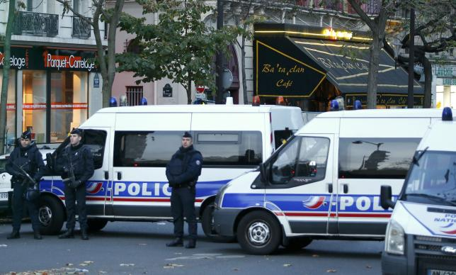 Police vehicles block the street in front of the Bataclan concert hall the morning after a series of deadly attacks in Paris