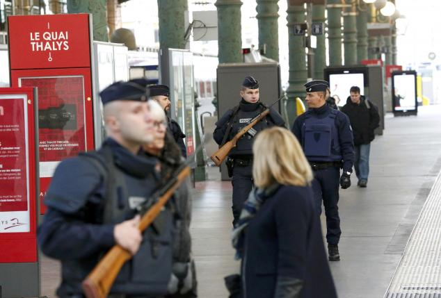 Police patrol the Gare du Nord train station the morning after a series of deadly attacks in Paris