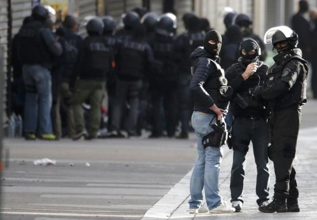 Members of French special police forces of the Research and Intervention Brigade are seen near a raid zone in Saint-Denis, near Paris