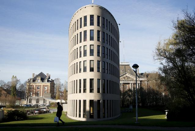 A pedestrian walks past a closed building of Flemish university VUB in Brussels
