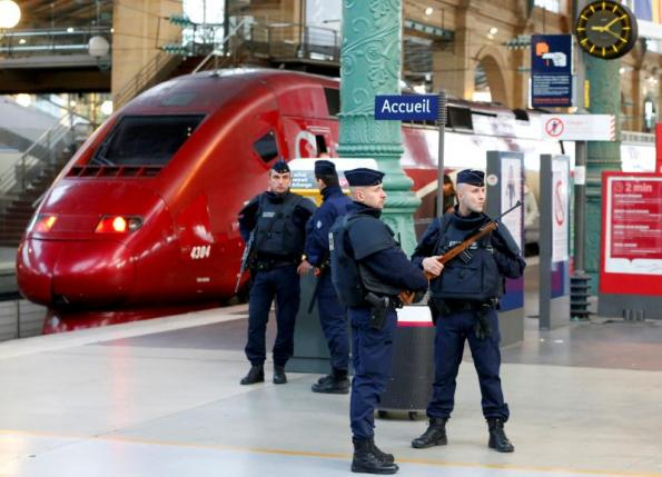 Police patrol the Gare du Nord train station near a Thalys train the morning after a series of deadly attacks in Paris