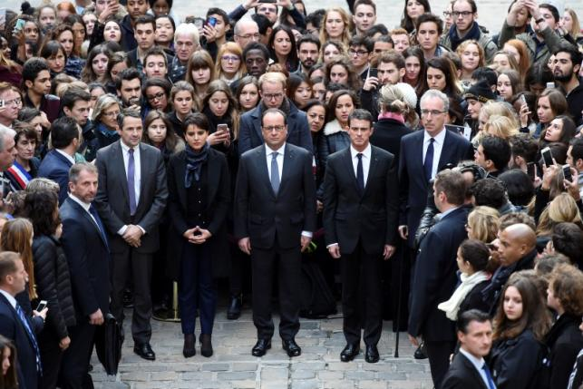 French President Francois Hollande observes a minute of silence at the Sorbonne University in Paris to pay tribute to victims of Friday's Paris attacks