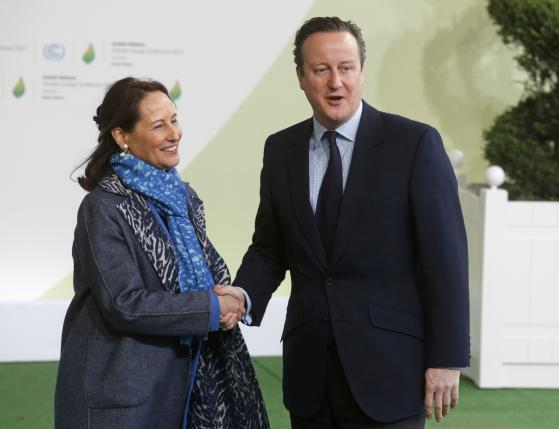 French Ecology Minister Royal welcomes Britain's Prime Minister Cameron as he arrives for the opening day of the World Climate Change Conference 2015 (COP21) at Le Bourget, near Paris