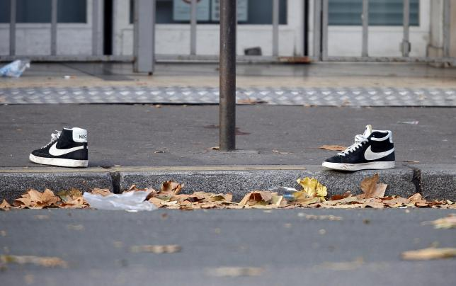 A pair of abandoned shoes seen left in the street near the Bataclan concert hall the morning after a series of deadly attacks in Paris