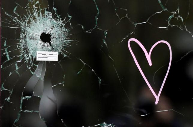 A bullet impact is seen in the window near the Le Carillon restaurant, one of the attack sites in Paris