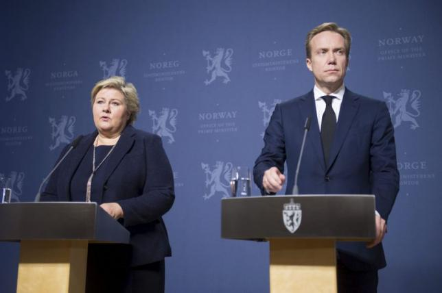 Norway's Prime Minister Erna Solberg and Foreign Minister Borge Brende attend a news conference in Oslo