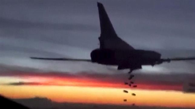 A still image shows a Russian bomber conducting an airstrike in Syria