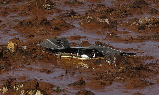 Debris of a house is pictured at Bento Rodrigues district, witch was covered with mud after a dam owned by Vale SA and BHP Billiton Ltd burst in Mariana