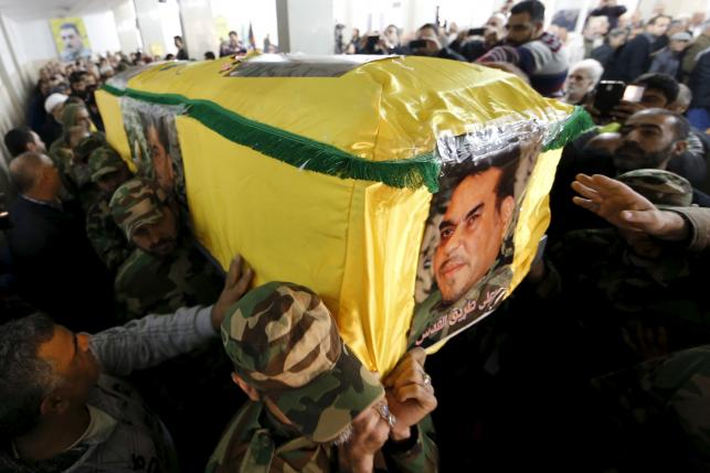 Hezbollah members carry the coffin of Lebanese Hezbollah militant leader Samir Qantar during his funeral in Beirut's southern suburbs
