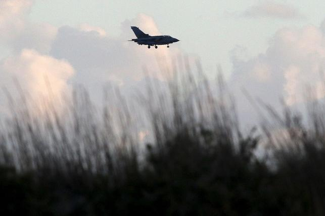 A British Tornado jet flies above RAF Akrotiri, a peninsula on the southern coast of Cyprus where Britain retains a military air base