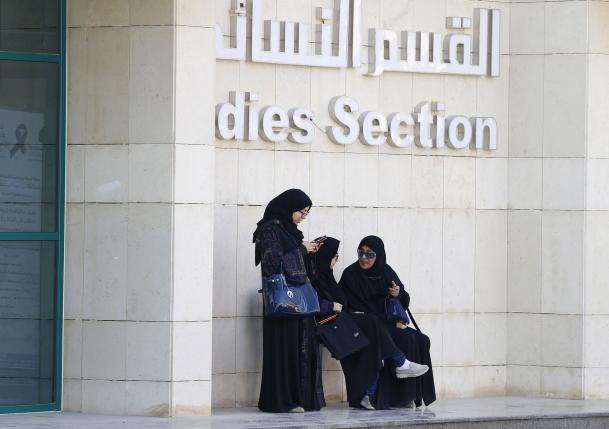 Women rest after casting their votes at a polling station during municipal elections, in Riyadh, Saudi Arabia
