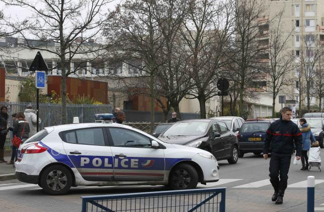 French police and firefighters are seen in front of the nursery school where a hooded man claiming to be acting for Islamic State attacked a  teacher with a knife in Aubervilliers