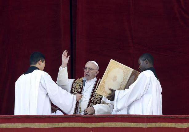 "Pope Francis makes a blessing during the ""Urbi et Orbi"" message from the balcony overlooking St. Peter's Square at the Vatican"
