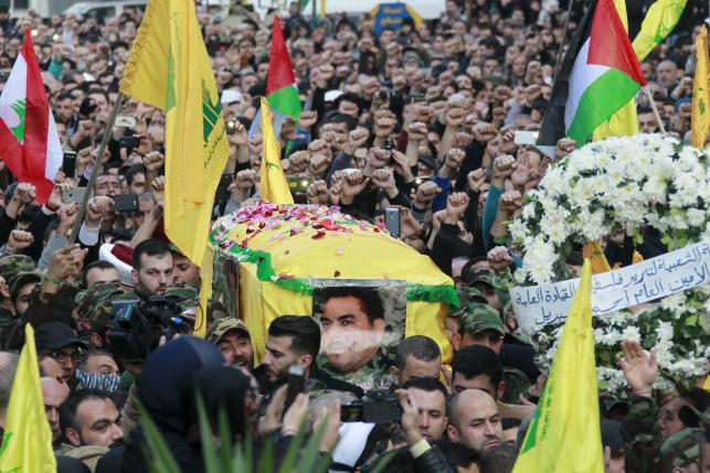 Hezbollah members carry the coffin of Hezbollah militant leader Qantar, as supporters wave Lebanese, Palestinian and Hezbollah flags, during his funeral in Beirut's southern suburbs, Lebanon