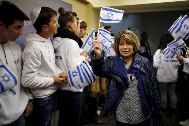 A Jewish immigrant from France arrives for a candle-lighting ceremony to mark the Jewish holiday of Hanukkah, upon landing at Ben Gurion International Airport