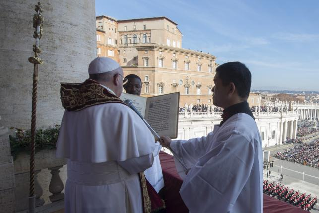"Pope Francis delivers a ""Urbi et Orbi"" Christmas message from the balcony overlooking St. Peter's Square at the Vatican"